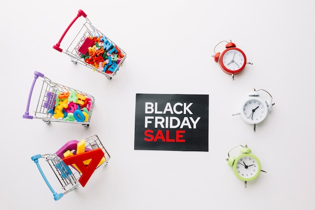 Viernes negro carros de compras y relojes