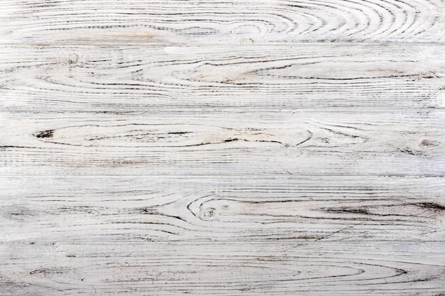 Vintage degradado textura de madera pintada de blanco en mal estado