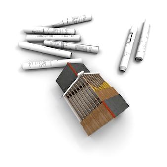 Vista aérea del modelo de arquitectura, con planos enrollados