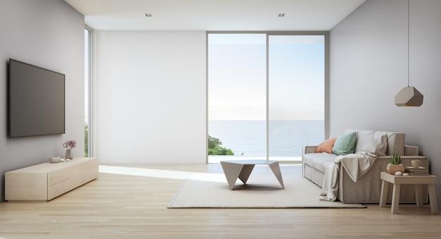 Vista al mar salón de casa de playa de lujo con puerta de cristal y terraza de madera.