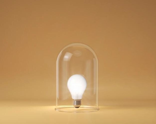 Vista frontal de la bombilla encendida protegida por vidrio transparente como concepto de idea