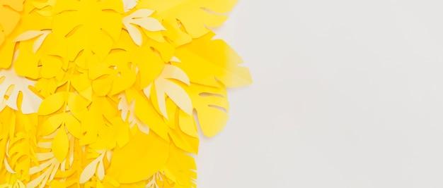 Vista frontal de hojas amarillas que inspiran felicidad con espacio de copia