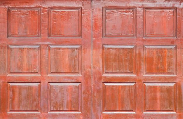 Vista frontal del panel de madera patrón, ventana o puerta de pared de madera paneles de madera grunge utilizados como fondo