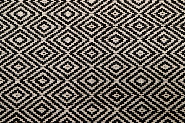 Vista frontal de la tela del patrón étnico blanco y negro para el fondo o banner