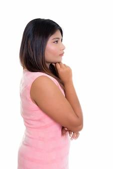 Vista de perfil de niña persa pensando