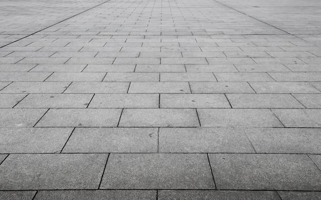Vista en perspectiva de la piedra de ladrillo gris monótono
