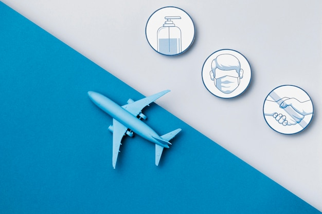 Vista superior del avión con logotipos de medidas de seguridad
