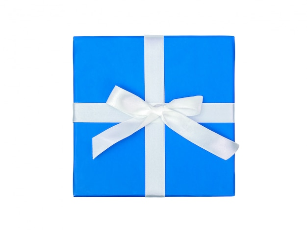 Vista superior de la caja azul con un regalo y lazo blanco