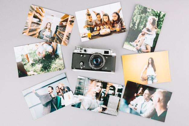 Vista superior cámara rodeada por fotos