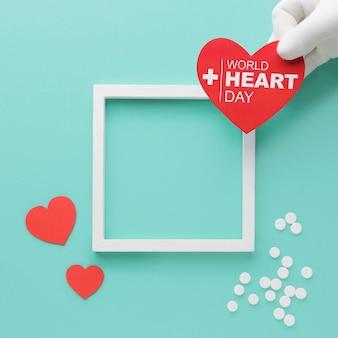 Vista superior del concepto del día mundial del corazón con marco