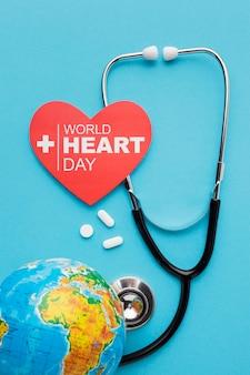 Vista superior del concepto del día mundial del corazón con la tierra