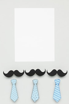Vista superior del concepto del día del padre con bigotes