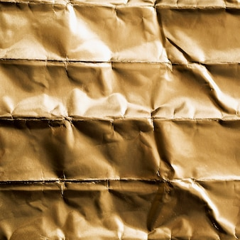 Vista superior cuadrada arrugada de oro