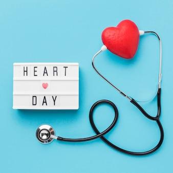 Vista superior del día mundial del corazón con estetoscopio