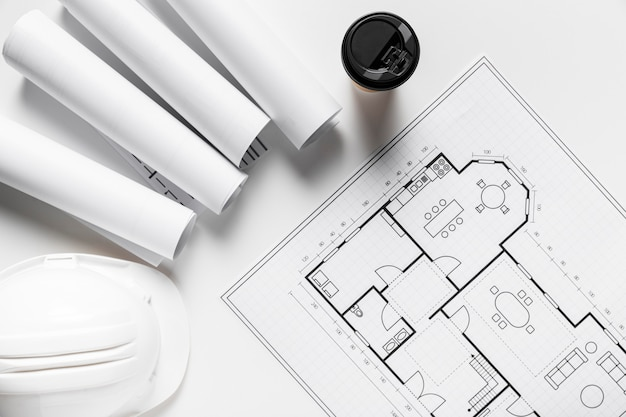 Vista superior disposición de elementos arquitectónicos sobre fondo blanco.