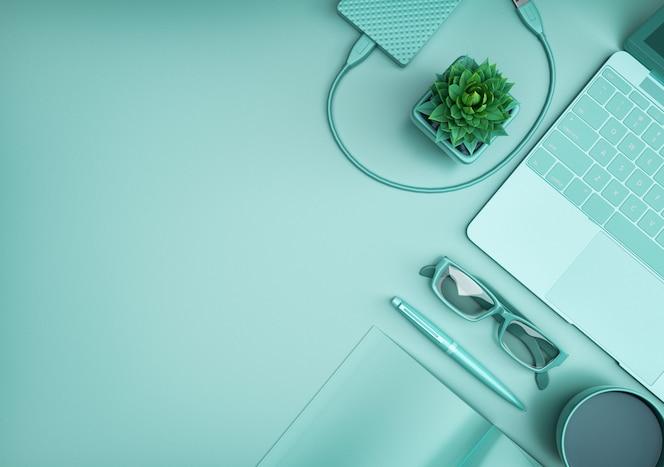 Vista superior del escritorio de oficina con computadora, fondo verde