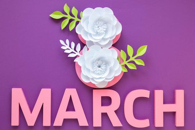 Vista superior de flores de papel con mes para el día de la mujer.