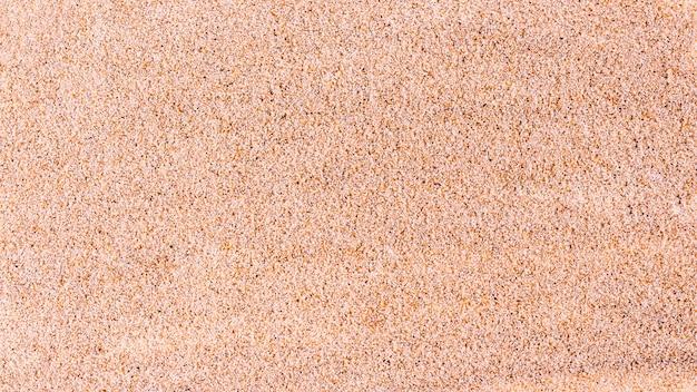 Vista superior del fondo de textura de arena fina.