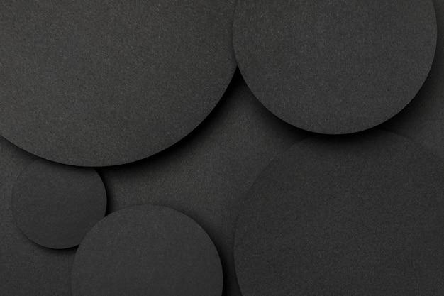 Vista superior grandes puntos de fondo de papel negro