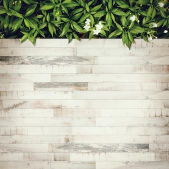 Vista superior del jardín y piso de madera. color vintage tonificado y espacio de copia, un lugar para la exhibición del producto.