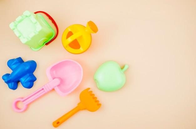 Vista superior juguetes de playa para niños