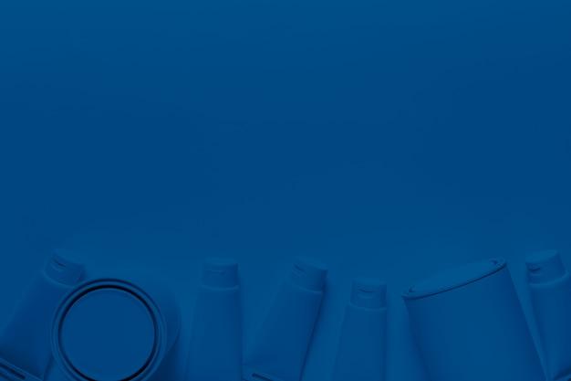 Vista superior de latas de pintura y contenedores en color azul clásico