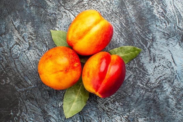 Vista superior de melocotones frescos frutos maduros