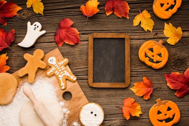 Vista superior mezcla de galletas de halloween con maqueta