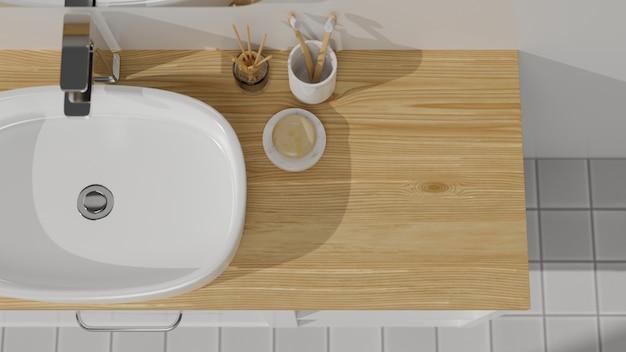 Vista superior de la parte superior del gabinete de madera con fregadero de recipientes, difusores de aroma, cepillo de dientes, jabón y espacio vacío