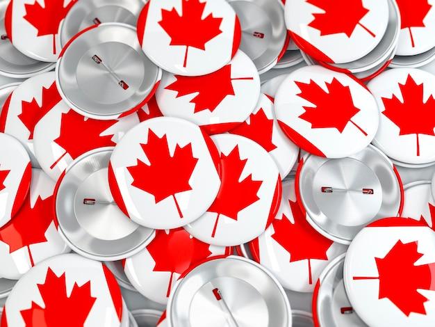 Vista superior de la pila de insignias de botón con la bandera de canadá. render 3d realista
