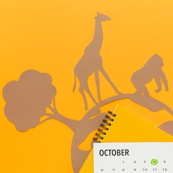 Vista superior del planeta de papel y animales para el día de los animales.