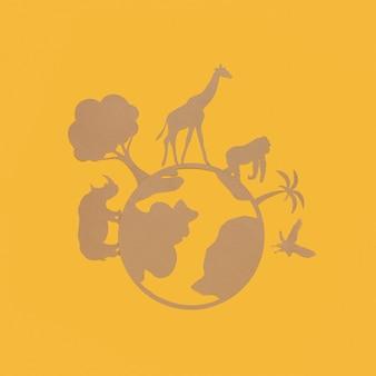 Vista superior del planeta de papel con animales de papel para el día de los animales.
