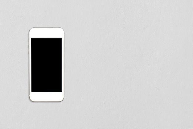 Vista superior smartphone simulacro plantilla con pantalla en negro sobre la mesa de cemento con copyspace.