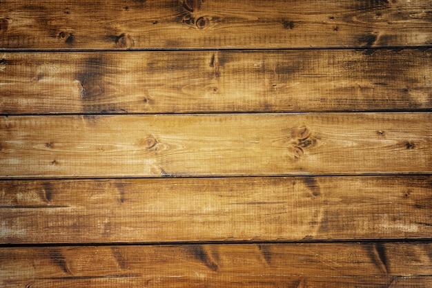 Vista superior de la superficie de madera de color marrón oscuro