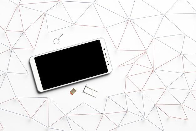 Vista superior del teléfono inteligente con tarjeta sim