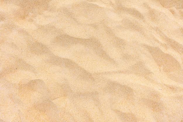 Vista superior de la textura de la arena en la playa