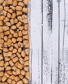 Vista superior de la textura de galletas con espacio de copia en blanco horizontal de madera