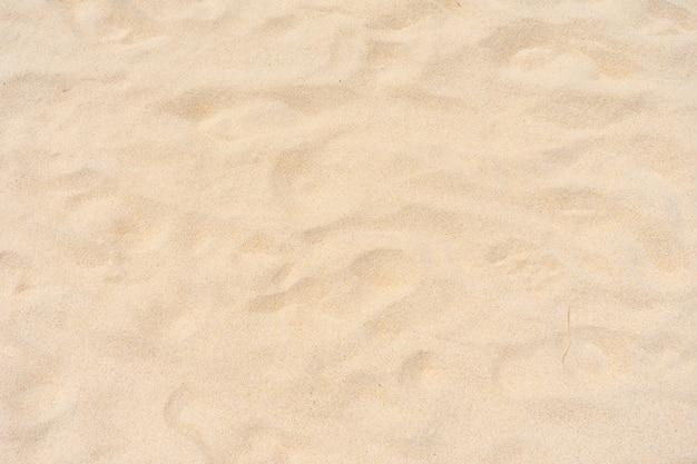 Vista superior de la textura de la playa de arena en la playa de la naturaleza en verano