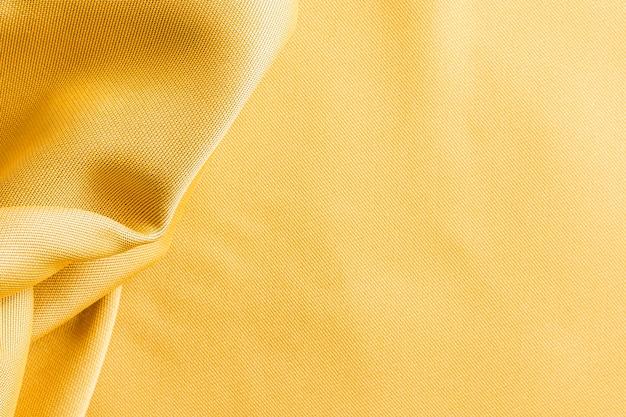 Vista superior de textura de tela dorada