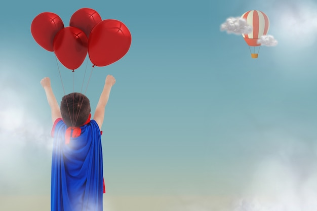 Vista trasera de niño con capa y globos