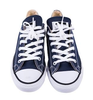 Zapatillas clásicas blancas aisladas.