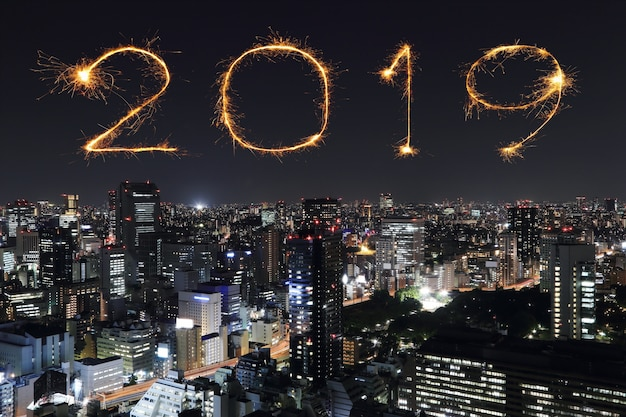 2019 happy new year firework sparkle with tokyo at night, japan