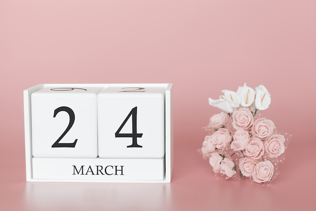 24 marzo. giorno 24 del mese. cubo del calendario sul rosa moderno