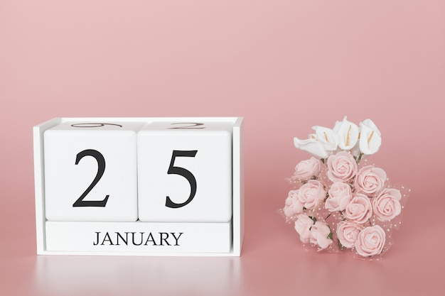 25 gennaio giorno 25 del mese. cubo del calendario su sfondo rosa moderno