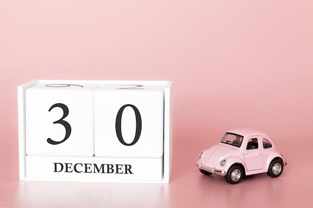 30 dicembre. giorno 30 del mese. cubo calendario con auto