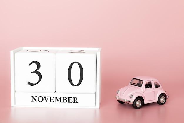 30 novembre. giorno 30 del mese. cubo calendario con auto
