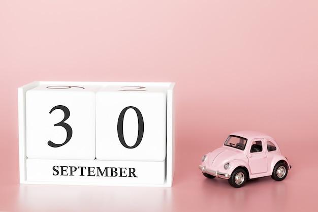 30 settembre. giorno 30 del mese. cubo calendario con auto