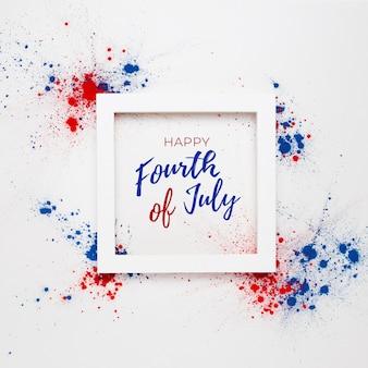 4 luglio sfondo con scritte in una cornice e fuochi d'artificio realizzati con macchie di colore holi