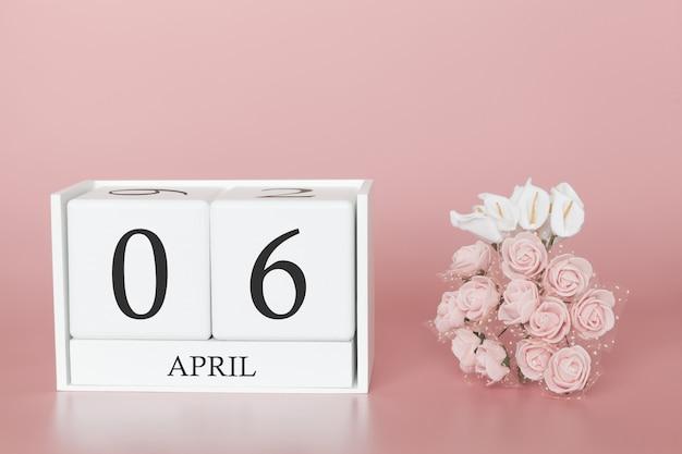 6 aprile. 6 ° giorno del mese cubo del calendario sul rosa moderno