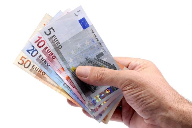 A mano moneta euro della holding
